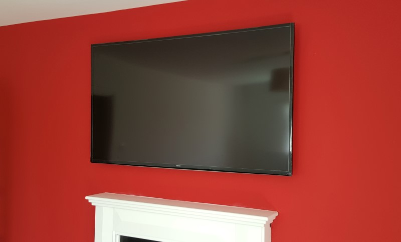 Lcd tv mounted above a fireplace carls services for What to hang on wall above tv