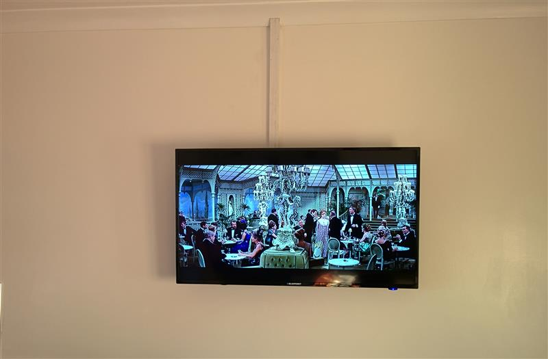 Wall mounted tv in a kitchen carls services for Small wall mounted tv for kitchen